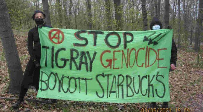 Finlandia, Helsinki: Banner na Globalny Tydzień Akcji Przeciwko Ludobójstwu w Tigraju i Korporacji Starbuck's